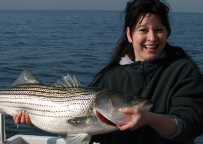Woman_striped-bass_spanky's_slider_1